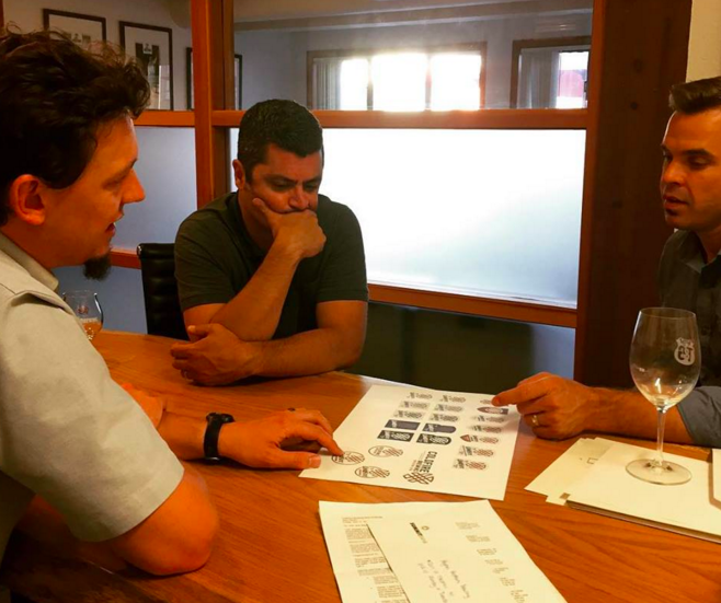 The ColdFire Brewing team meets to plan marketing.