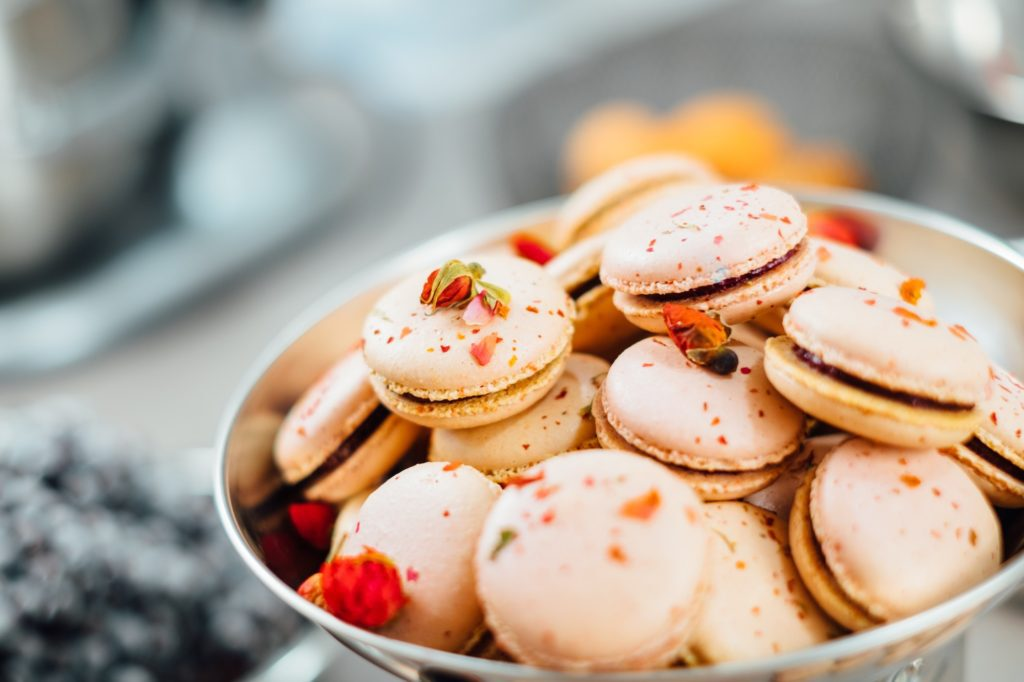 French macarons in a bowl; how to start a bakery business