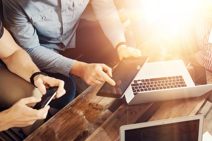 Using laptop, tablet, and smartphone; app versus website concept