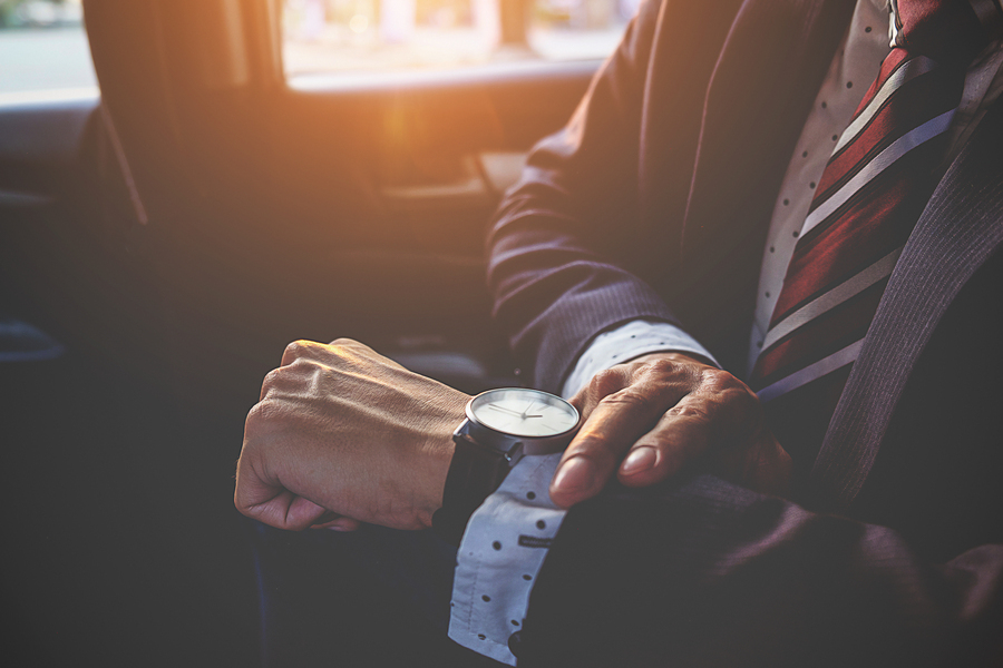 Business man looking at his watch; VC funding concept